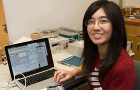 Young female engineer at computer