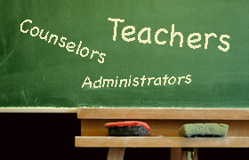 Chalkboard with words teacher, counselor, administrator