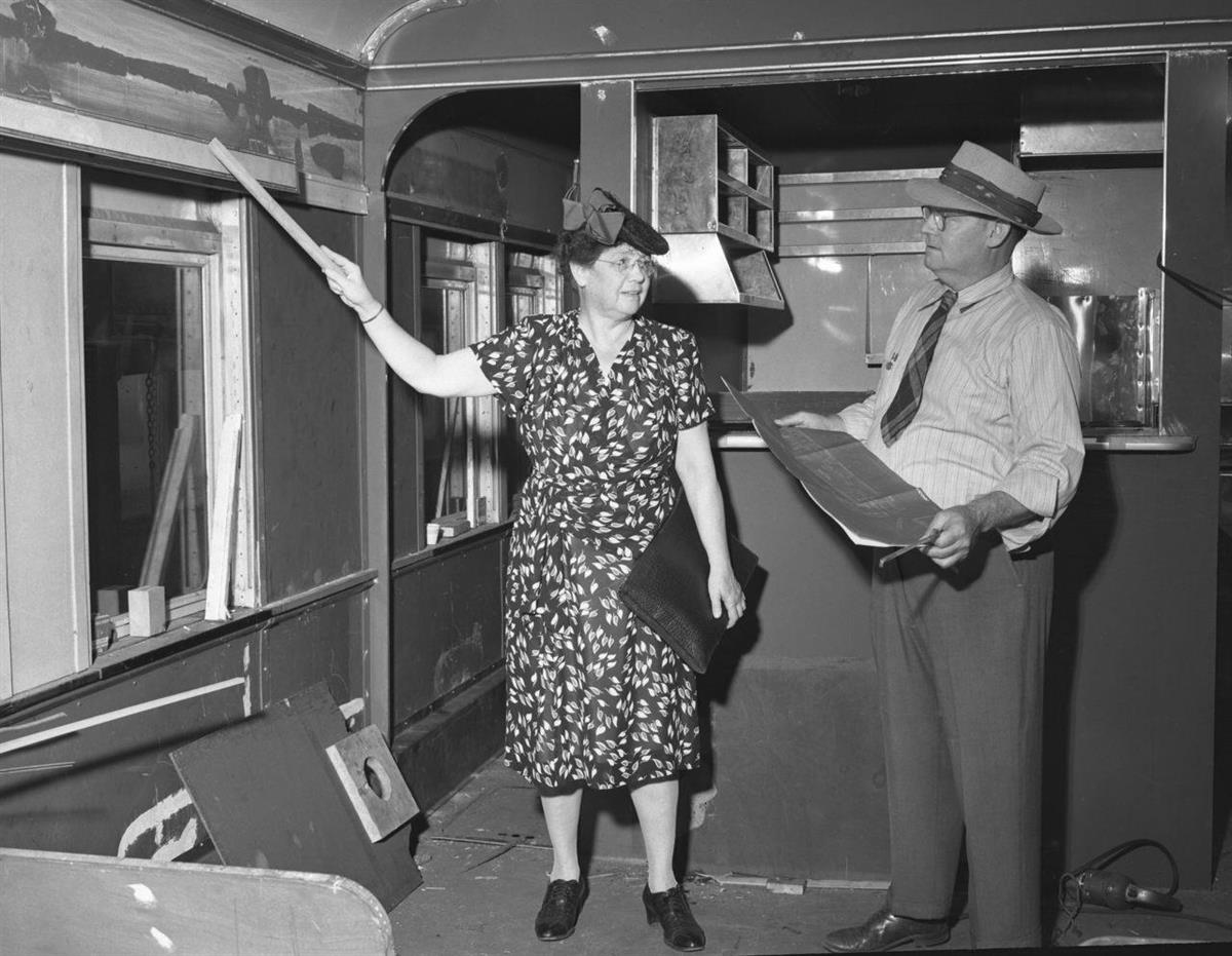 Ruth Dennis points out improvements to a railrad buffet car