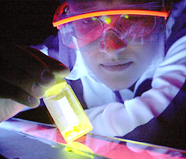 Chemical engineer Amanda Aker examines a polymer that is a key component in detecting landmines and sensing explosives.